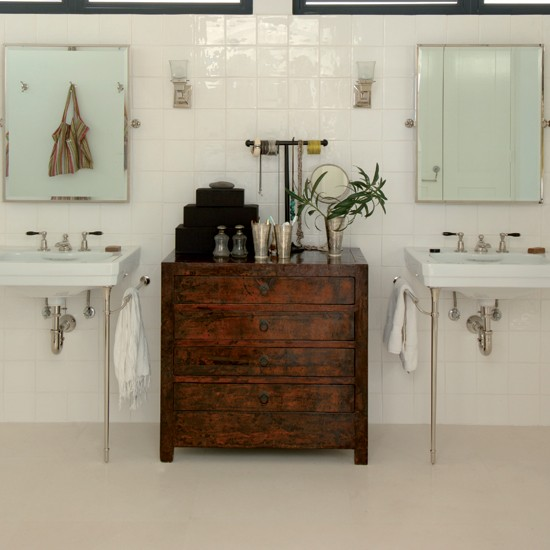 Bathroom with twin basins, pine chest of drawers and polished concrete floor