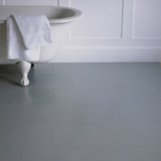 White bathroom with grey rubber floor