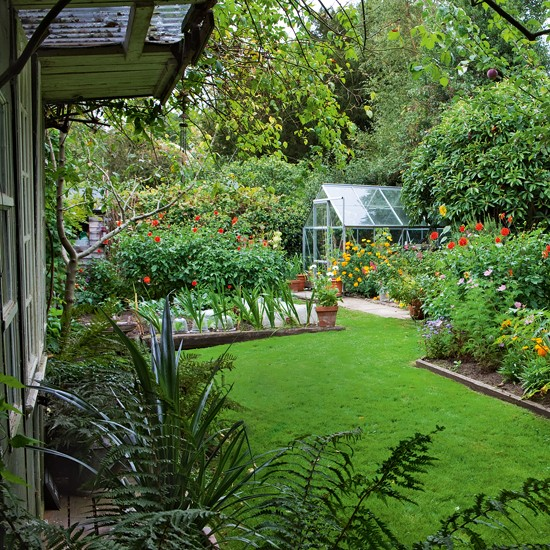 Flower garden with greenhouse country cottage garden for Country garden design ideas