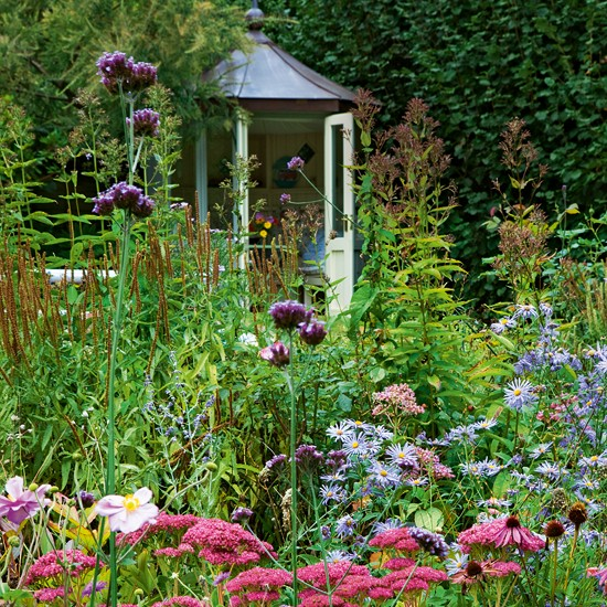 Flower garden with outhouse country cottage garden tour for Country garden ideas for small gardens