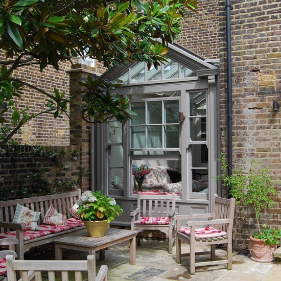 Traditional garden room with adjacent patio garden rooms for Best garden rooms uk