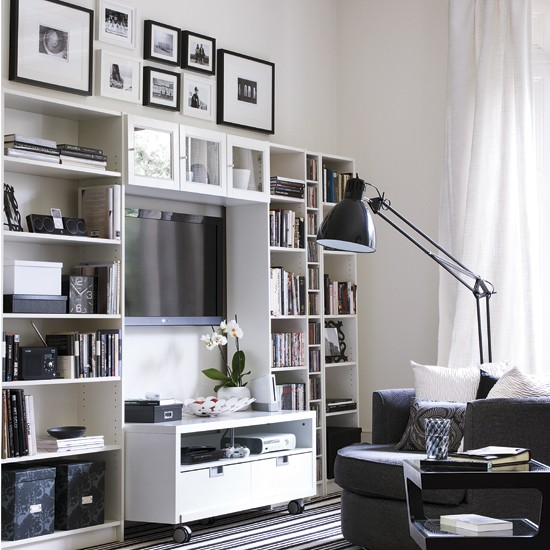 Black and white room with wall shelving