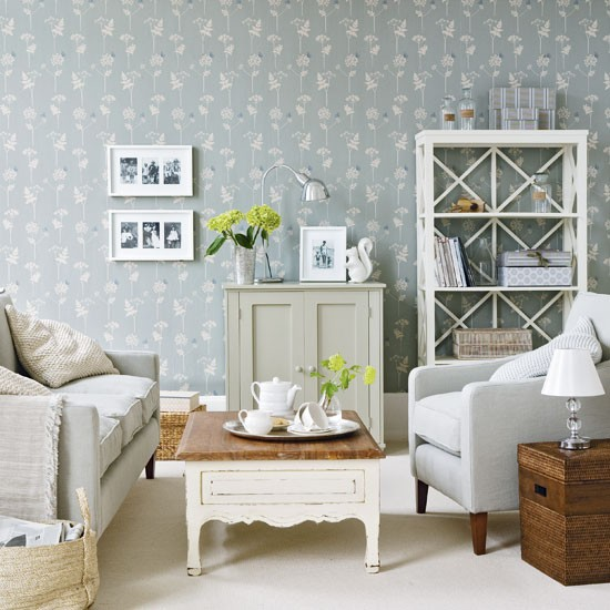 Living room with blue floral wallpaper and neutral furniture