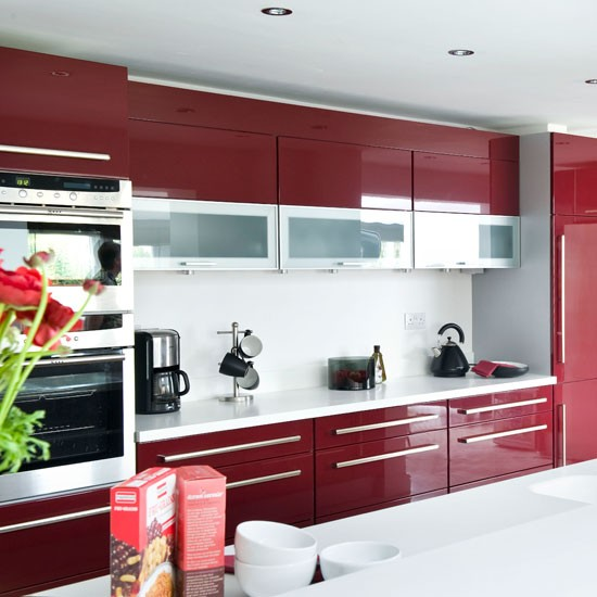 Storage units modern burgundy kitchen tour housetohome for Burgundy kitchen cabinets pictures