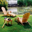 Adirondack armchairs, £525 each; foot rests, £210 each; side table, £185, all Barlow Tyrie.