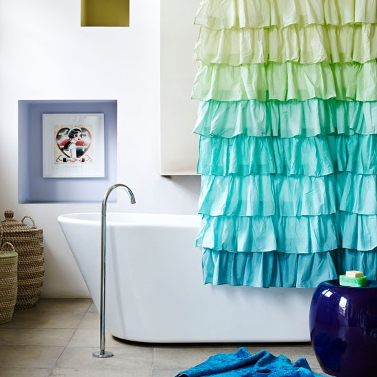 Nina Campbell designed bathroom with colourful shower curtain