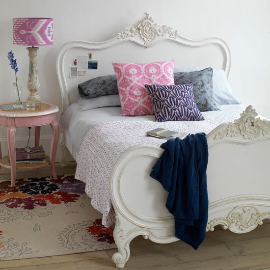 Bedroom with vibrant soft furnishings | Bedroom design | Patterned cushions | Image | Housetohome
