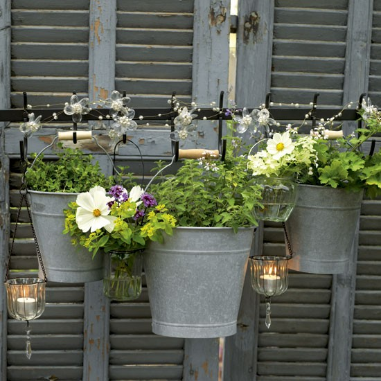 Garden hanging pot display | Garden design | glass jars | Image | Housetohome