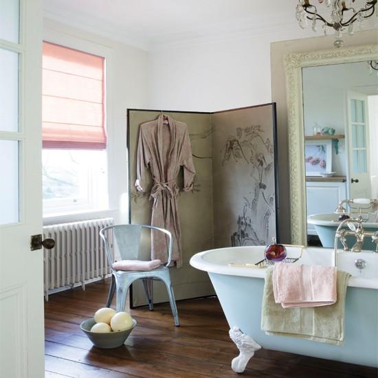 Glamorous bathroom with wood floor freestanding bath chair large