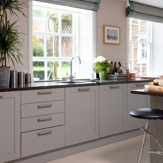 Timeless Kitchen Design Ideas image of transitional kitchen design ideas Kitchen With Pale Wood Floor Soft Grey Units Black Granite Worktops And Black Bar