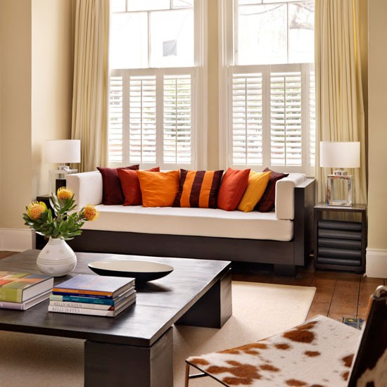 Modern Black House Bright Accents With Bright Accents Orange Cushion Living Room Design Modern