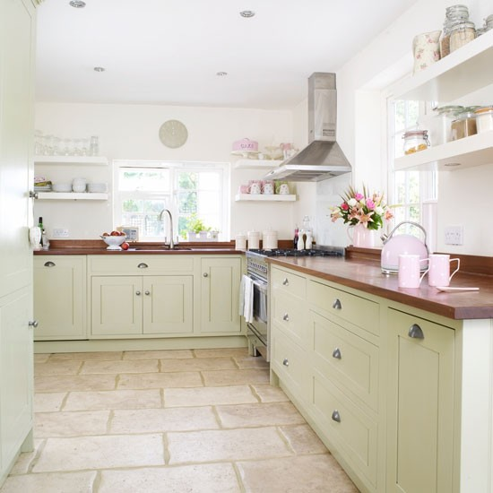 Take a tour of a modern country kitchen makeover for Country cottage floor tiles