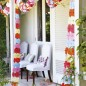 White chairs on front garden patio framed by garlands