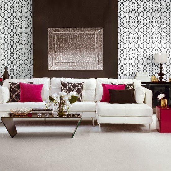Living room with geometric wallpaper and white sofa
