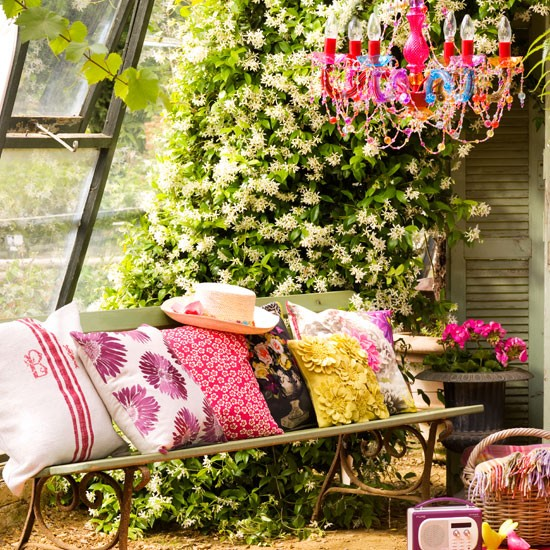 Cushioned love seat | how to create a garden retreat | garden design ideas | housetohome