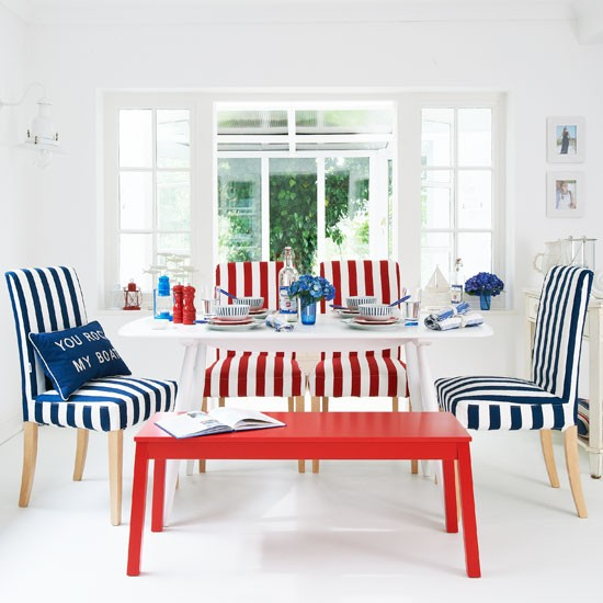 White Striped Chairs A Red Coffee Table And Console To Side