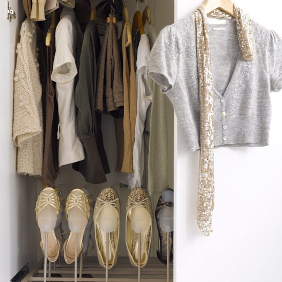 Wardrobe filled with clothes, shoe storage area