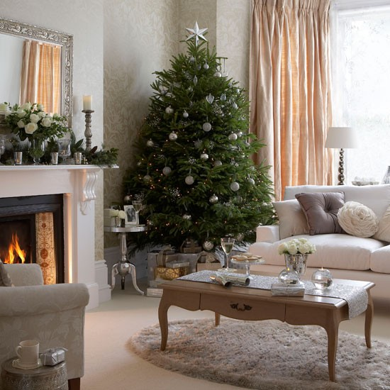 Cosy Christmas living room with Christmas tree, neutral wallpaper and wood coffee table