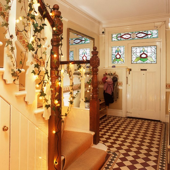 Festive hallway step inside this cosy christmas retreat How to decorate your hallway for christmas