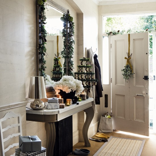 Traditional Hallway With Christmas Decorations On Console Table