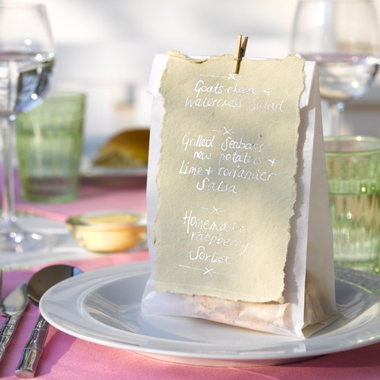 Peg little menus to bags of treats for cute table settings \ Dan Duchars