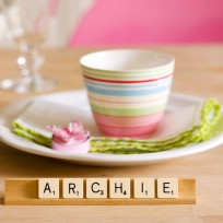 Use Scrabble tiles to spell out guests' names