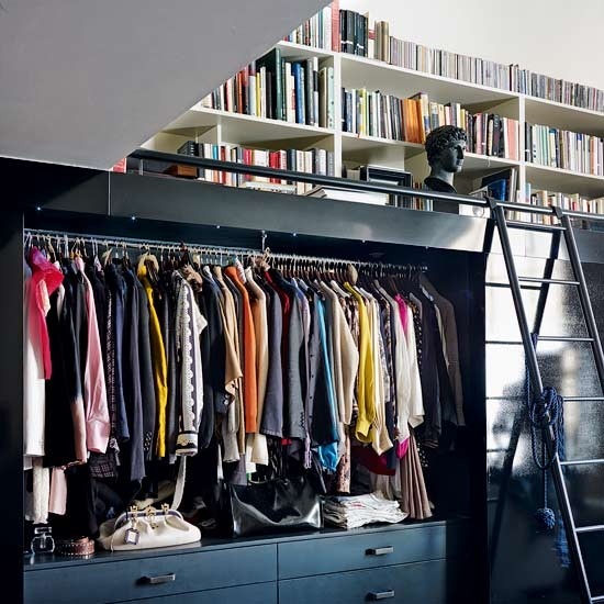 Wardrobes and library take a look inside a dark for Inside wardrobe storage