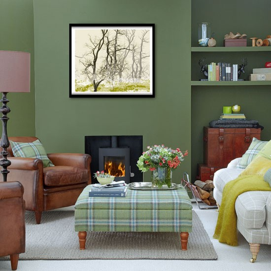 this living room teams dark green with earthy browns and yellows for a