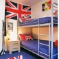 Boys' bedroom with metal bunk beds and Union Jack flag