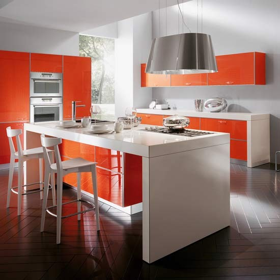 Kitchen with white walls, white kitchen island, white quartz worktops and orange Crystal kitchen units