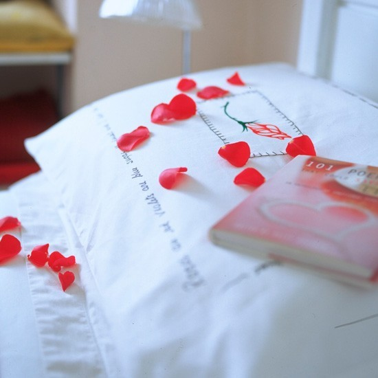 Set the scene with rose petals for a romantic Valentine&#039;s Day
