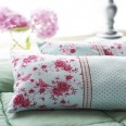 Transform your bed with some pretty floral cushions