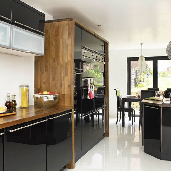 Walnut worktop Be inspired by this contemporary black  : kitchen units contemporary Ideal home from www.housetohome.co.uk size 550 x 550 jpeg 61kB