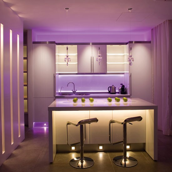 John Cullen Lighting's RGB Slinky, £150m, has been used behind the splashback at high and low levels. Oslo lights, £119, and Cazella 1W LEDs, £8, have been recessed 