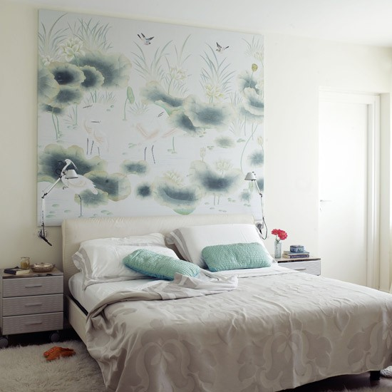 feng shui bedroom with double bed bedside table and canvas on wall