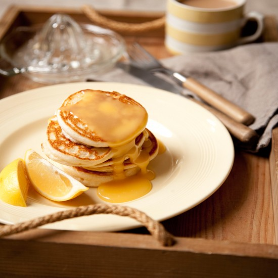 Pile up these fluffy pancakes on the plate and serve with the lemon sauce