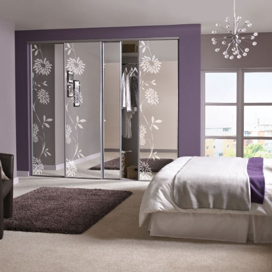 Sliding mirrored wardrobes from b q fitted wardrobes for Bedroom wardrobe interior designs