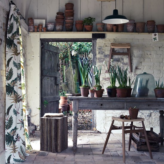Botanical garden room with rustic kitchen table and stools