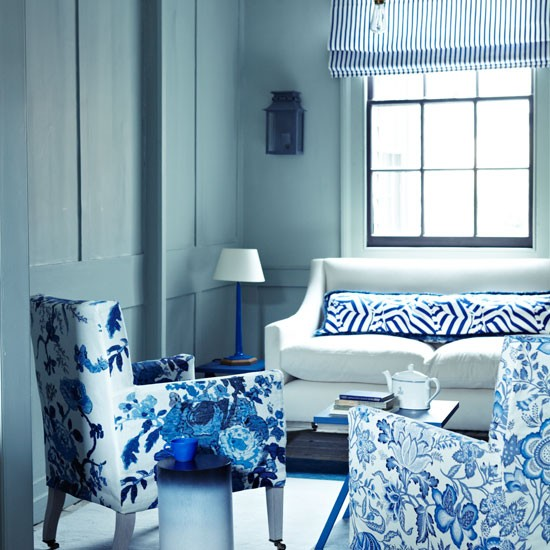 blue and white living room with florals and stripes design ideas