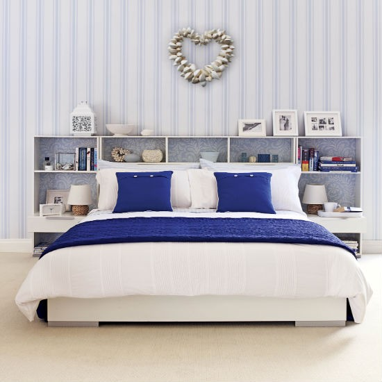 Blue and white coastal bedroom with striped wallpaper