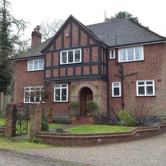 Real homes elegant 1930s surrey house for Beautiful home exteriors