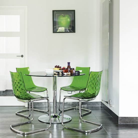 Modern Dining Room With Green Accessories