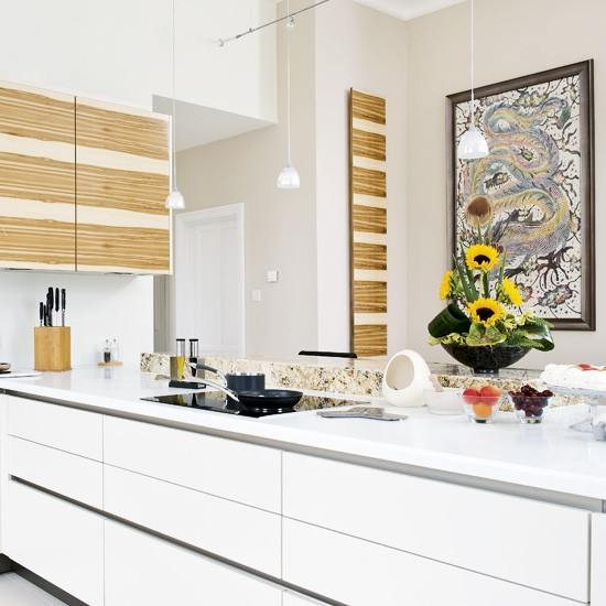 White kitchen with wood artwork | White kitchen design ideas