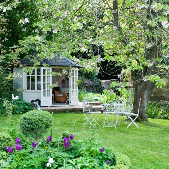 Country garden pictures house to home for Garden designs with summer houses