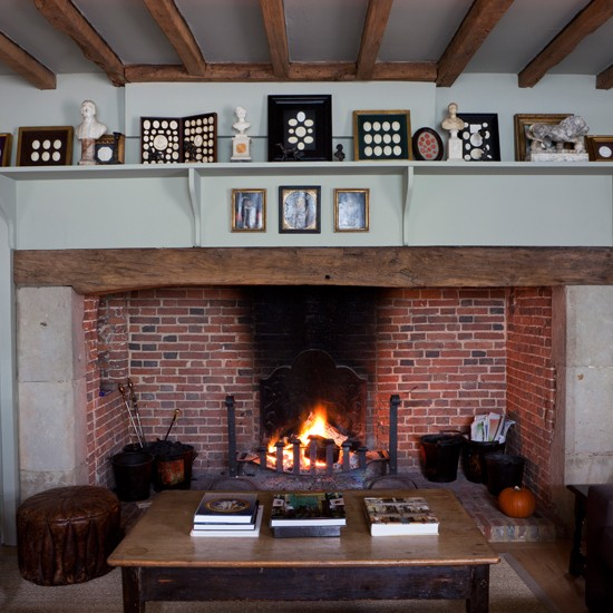 Traditional fireplace with busts | Classic British decorating ideas to celebrate the Queen's Jubilee