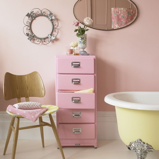 Pastel pink bathroom with yellow freestanding bath Pink bathroom ideas pictures