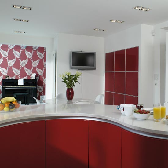 Curved Units Take A Tour Around A Striking Red Kitchen