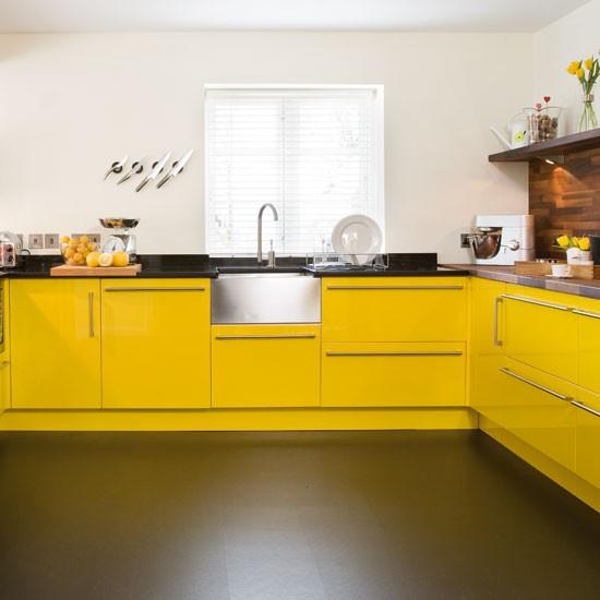 Sink take a tour around a bright yellow kitchen for Coloured sinks kitchens