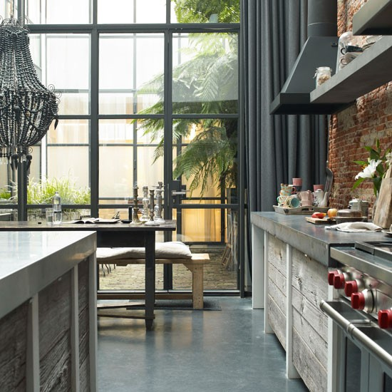 Rough reclaimed timber, smooth concrete worktops and clean stainless ...