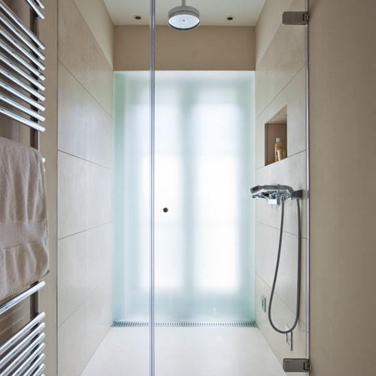 Space saving bathroom with large format tiles en suite for Small ensuite bathroom